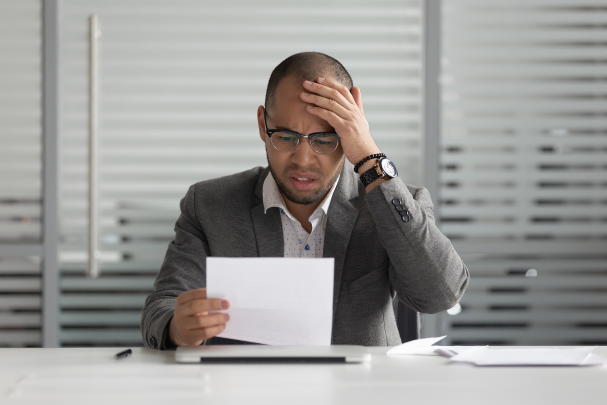 Stressed-out man battling with loan anxiety.